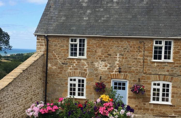 Frog by the Sea Cottage is a beautiful 17th century semi-detached cottage with stunning views