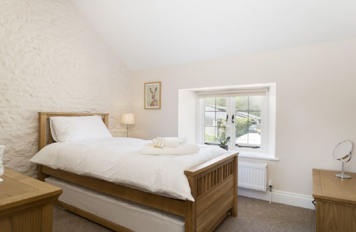 First floor: Bedroom three with single bed