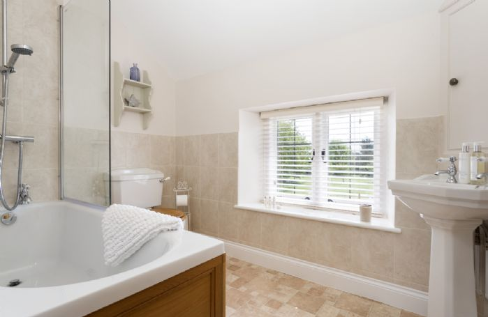 First floor: Family bathroom with bath and shower over