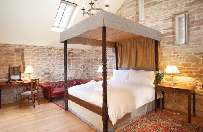 First floor: Master bedroom with 5' four poster bed with en-suite bathroom with a separate shower