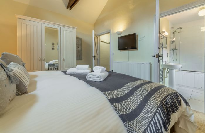 Ground floor: Bedroom one with king-size bed and en-suite bathroom