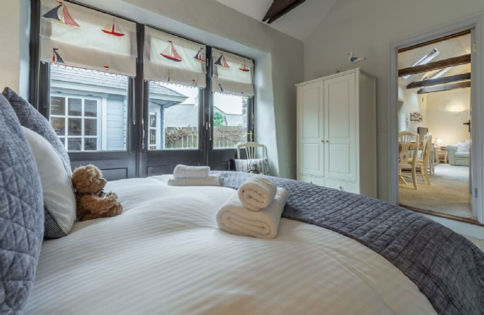 Ground floor: Bedroom two with king-size zip and link bed and en-suite shower room