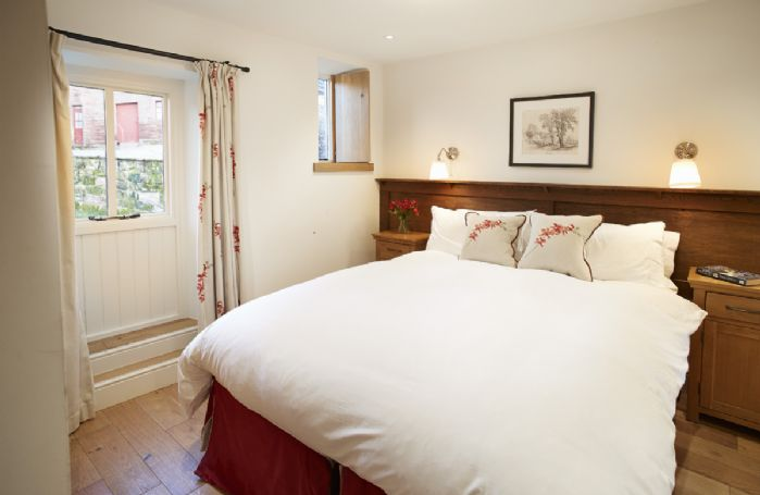 Ground floor: Double bedroom with 5' zip & link bed which can be configured as twin beds upon request