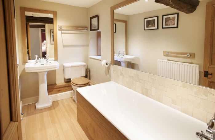 First floor: En-suite bathroom to double bedroom with 5' zip and link beds