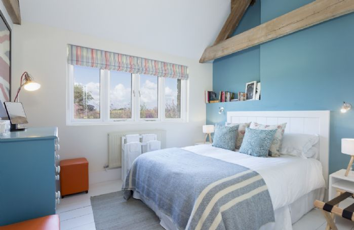 Ground floor: Bedroom with 5' king size bed and open views to garden