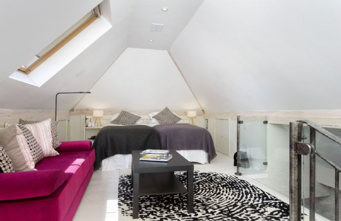 Above the entertainments room: Bedroom with 6' super king zip and link bed with en-suite