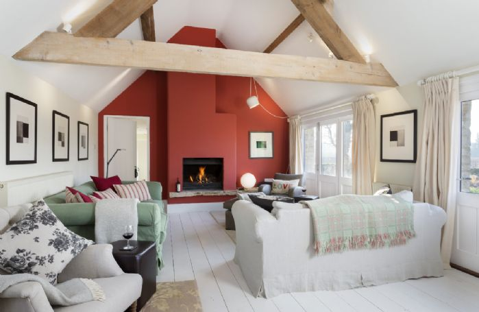 Ground floor: The generously sized sitting room with open fire and ample seating for guests