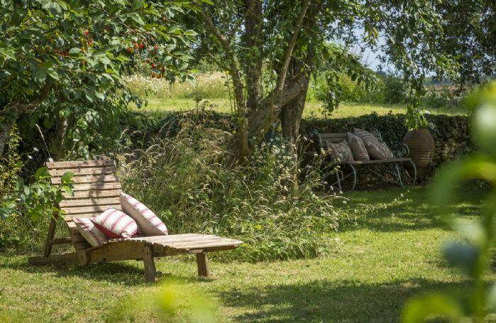 Lounger and bench seating in the Orchard garden