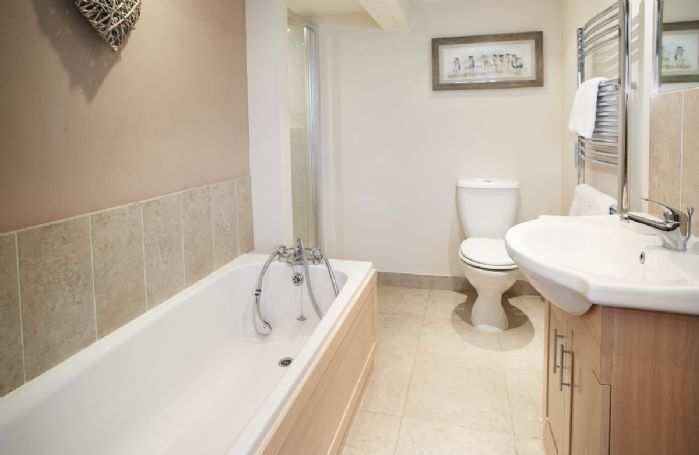 Ground floor: Large bathroom with walk-in shower and separate bath