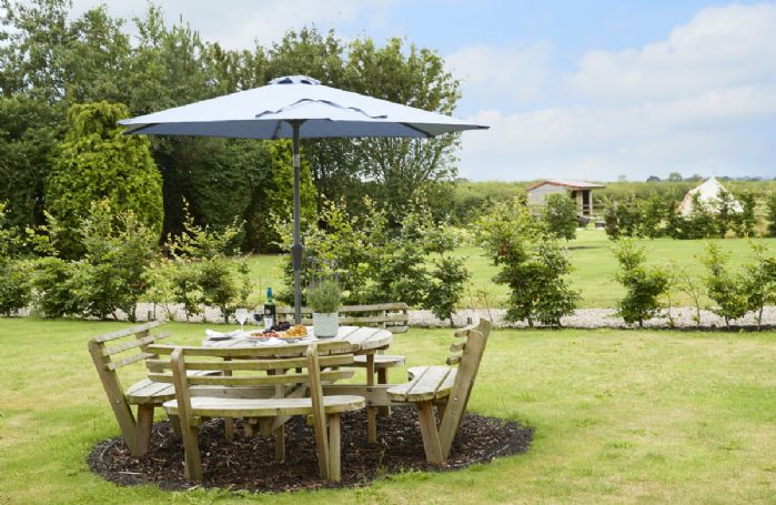 Garden table and chairs overlooking the beautiful lawns