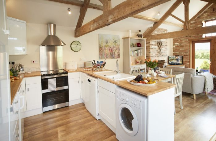 Ground floor: The well-equipped kitchen in the open plan living area