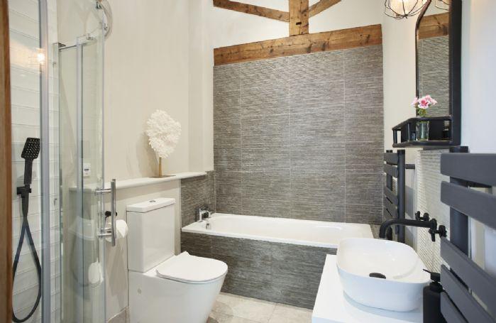 Ground floor: Master en-suite bathroom with bath and separate shower