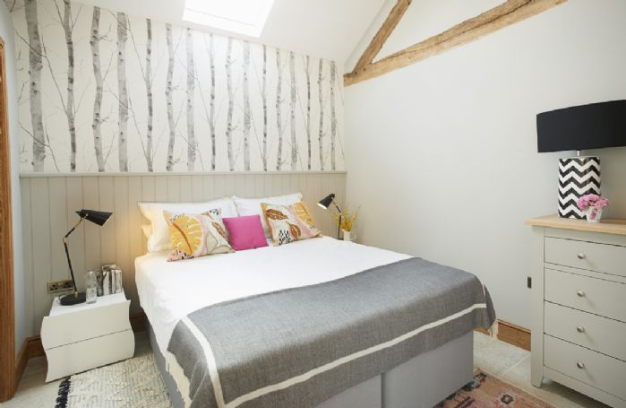 Ground floor: Spacious bedroom with a double zip and link bed and en-suite shower room