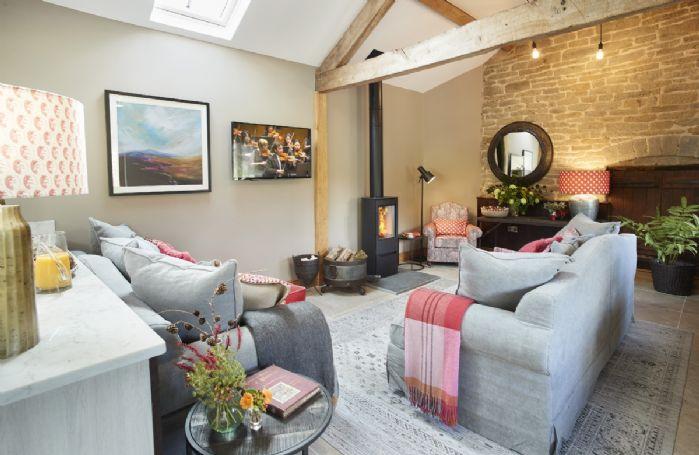 Exposed beams, stone wall and plush furnishings