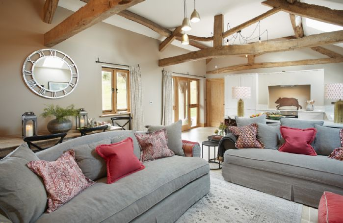 Ground floor: Open plan sitting room with access to a terraced area