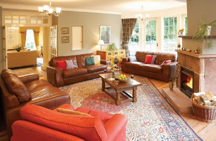 Ground floor: Comfortable sitting room with open fire