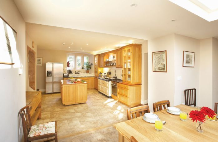Ground floors: Fully equipped kitchen leading onto large orangery