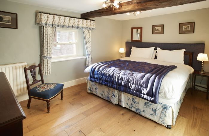 First floor: Double bedroom with a 5' zip and link bed which can be convert to two 3' beds upon request and en-suite