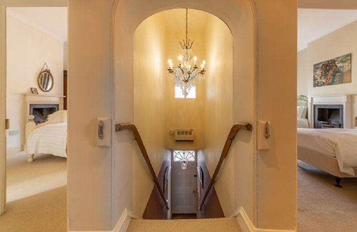 First floor: One of the two stairways leading to bedrooms two and three
