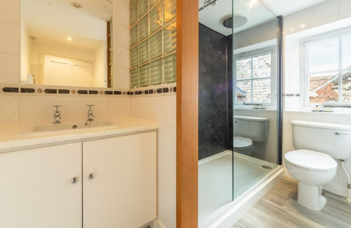 First floor: Family bathroom with WC, wash basin and walk-in shower