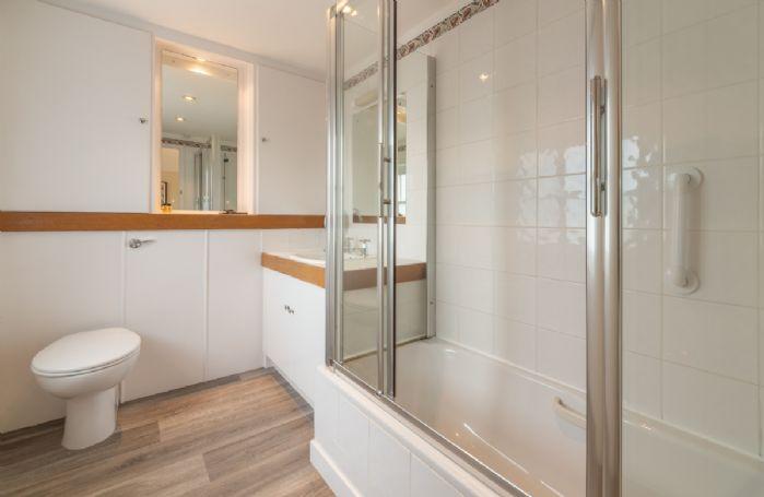 First floor: Master bedroom en-suite with power shower over the bath