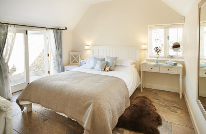 Ground floor: Double bedroom with 6' king size bed