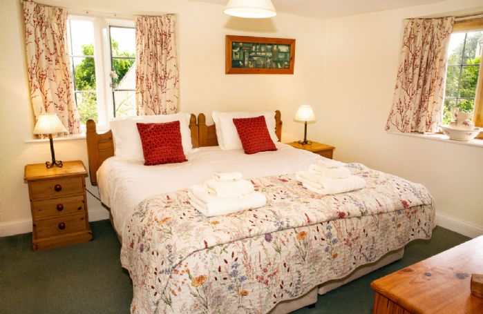 First floor: Double bedroom with 6' zip and link bed which can convert to two 3' single beds with en suite shower room