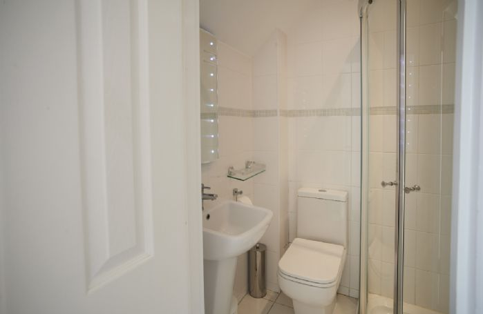 First floor: En-suite shower room with megaflow pressure