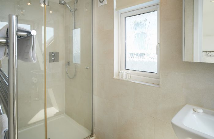 First floor: Luxury en-suite shower with megaflow pressure.