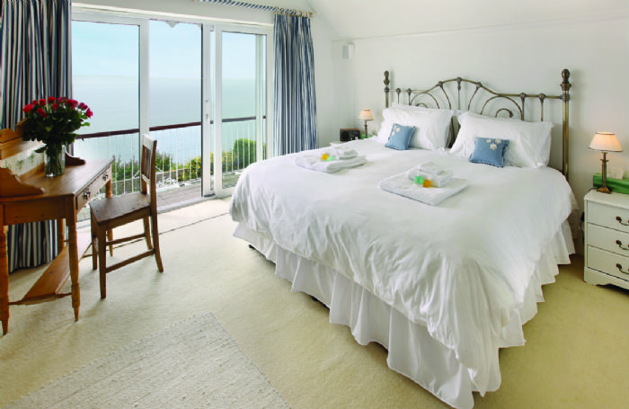 First floor: Master bedroom with a 6'6 bed with magnificent views and en suite bathroom