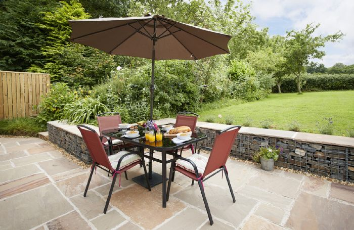 Patio and garden at Orchard View with garden furniture for al fresco dining