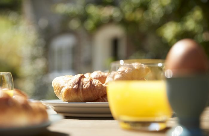 Enjoy a delicious breakfast al fresco with stunning views of the gardens