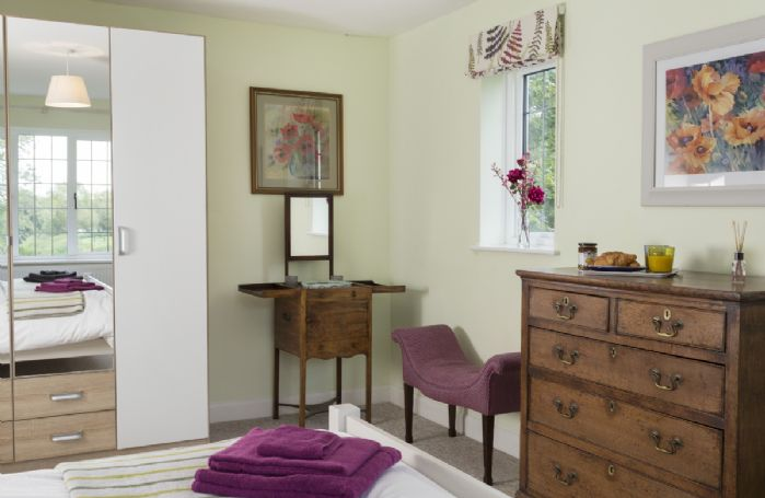 First floor: Double bedroom with period furniture including an antique wash stand