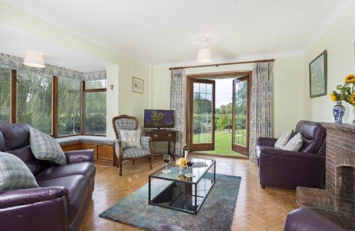 Ground floor: Spacious sitting room overlooking the River Avon