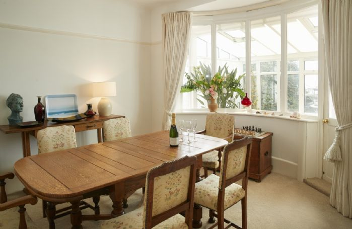 Ground floor: Dining room next to the sitting room with bay window