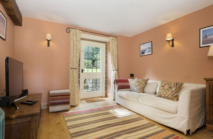 Ground floor: Snug room with television and access to garden