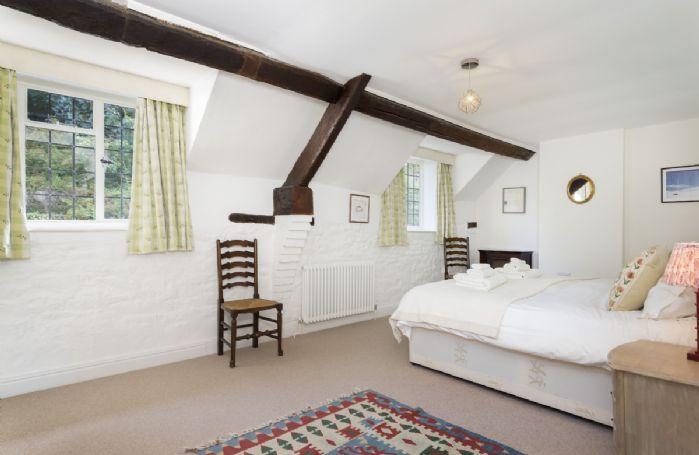 First floor: Master bedroom with 6' zip and link beds with en-suite bathroom