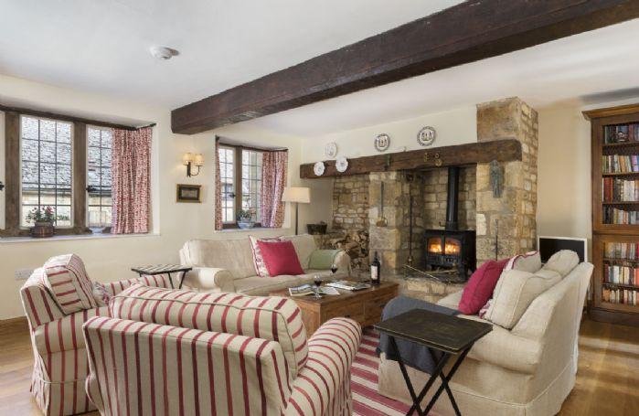 Ground floor: Spacious sitting room with wood burning stove