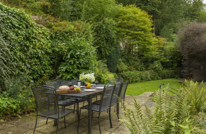 Garden table seating eight guests in the private and enclosed terraced garden