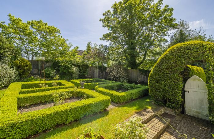 There are extensive, mature gardens to explore at The Old Rectory