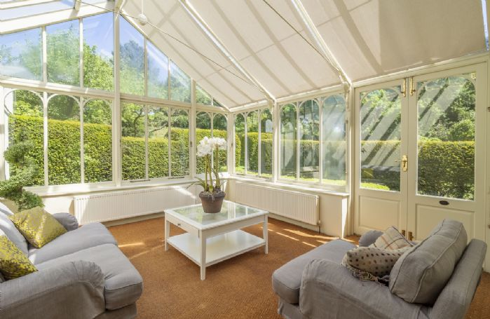 Ground floor: Conservatory with views on to the garden