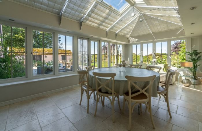 Ground floor: The orangery with table and seating for ten