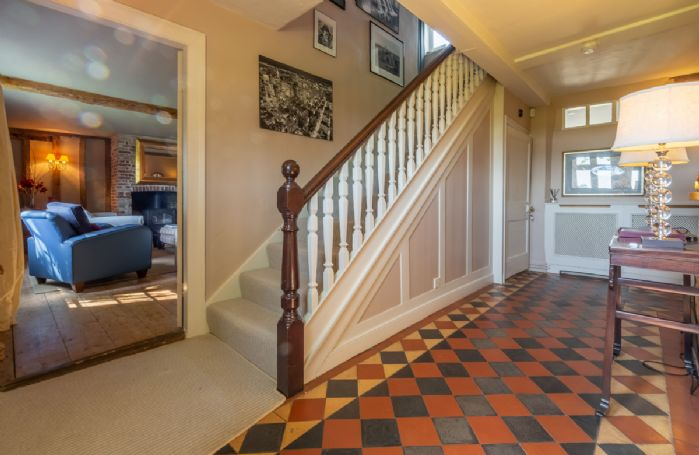 Ground floor: Hallway with stairs to first floor
