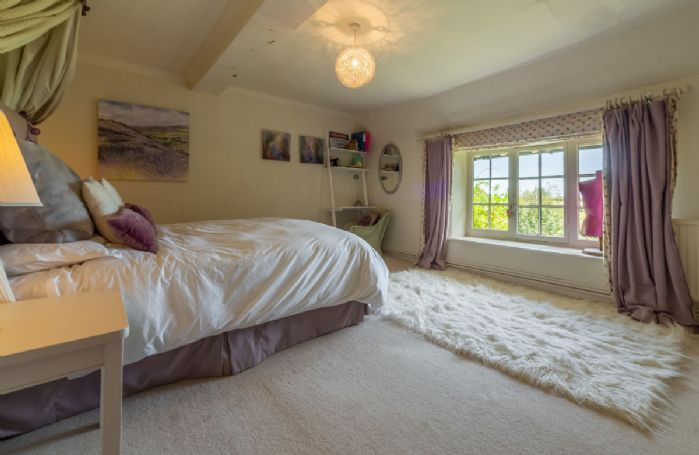 First floor: Bedroom four with double bed