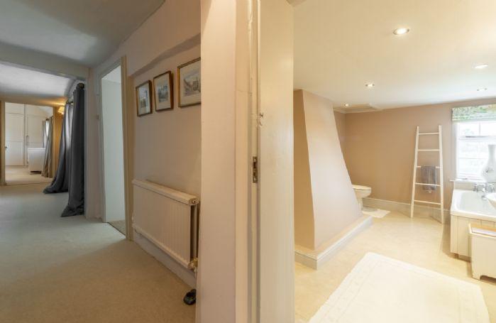 First floor: Hallway leading to family bathroom