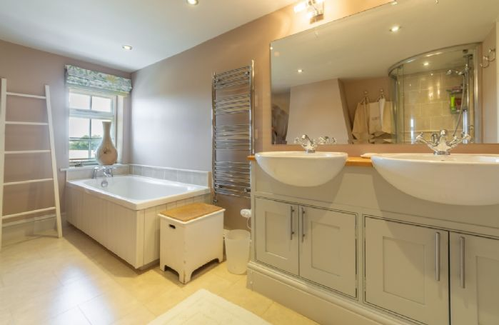 First floor: Family bathroom with separate bath and shower and his and hers wash basins