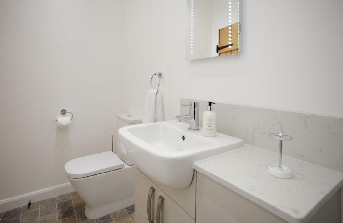 Ground floor: En-suite shower room with walk in shower