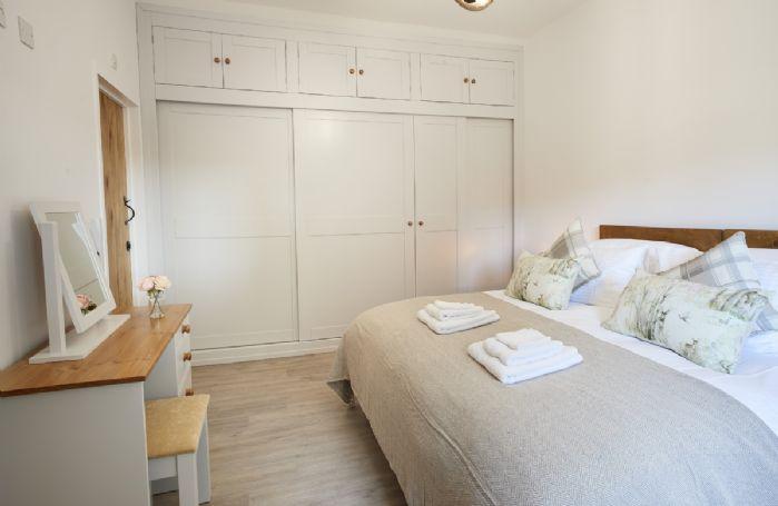 Ground floor: Master bedroom with 6' super king bed and en-suite bathroom