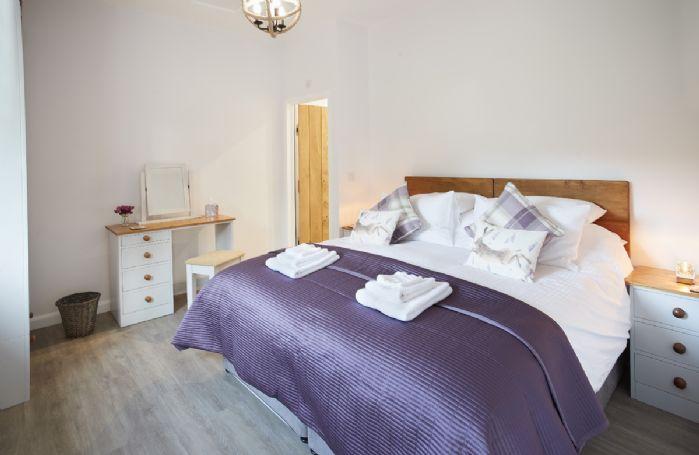 Ground floor: Double bedroom with 6' super king bed and en-suite shower room