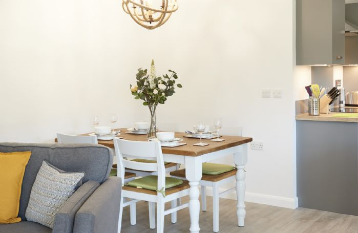 Ground floor: Dining table in the open plan living area seating four guests
